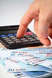 Calculatrice et argent - concept de journalisation Photographie stock