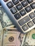 Calculatrice et argent liquide II images libres de droits
