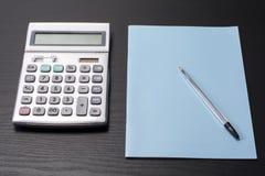 Calculatrice et carnet Image libre de droits
