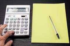 Calculatrice et carnet Images stock