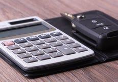 Calculatrice et clé Images libres de droits
