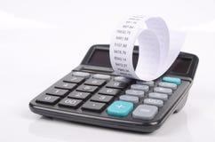 Calculatrice et compte photographie stock
