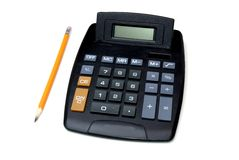 Calculatrice et crayon Photographie stock