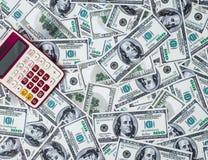 Calculatrice et 100 dollars images libres de droits
