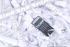 Calculatrice et papier de rebut Images libres de droits