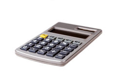 Calculatrice grise d'isolement sur le fond blanc Image stock