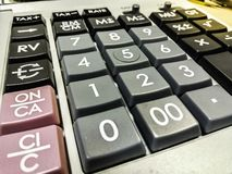 Calculatrice pour des calculs photo stock
