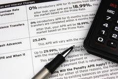 Calculatrice sur des conditions de crédit Photographie stock