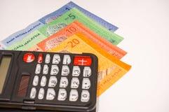 Calculatrice sur des notes de la Malaisie Photographie stock