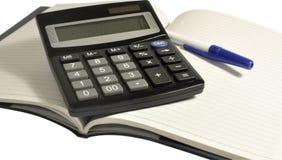 calculatrice sur le cahier Photographie stock