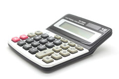 Calculatrice sur un fond blanc Photographie stock