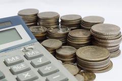 Calcule moedas fotografia de stock