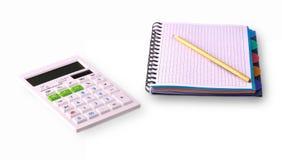Calcule, notebooke e lápis no fundo branco fotografia de stock royalty free