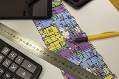 Calcurator, pen and ruler on building house architecture plan drawing blueprint. Planning, measurement and investments concept royalty free stock images