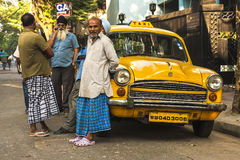 Calcutta characteristic yellow cabs Royalty Free Stock Photo