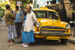 Calcutta characteristic yellow cabs Royalty Free Stock Photos