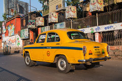 Calcutta characteristic yellow cabs Royalty Free Stock Photography