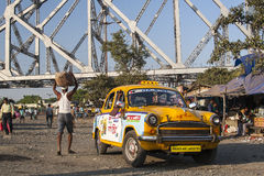 Calcutta characteristic yellow cabs Royalty Free Stock Images