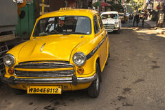 Calcutta characteristic yellow cabs Stock Photos