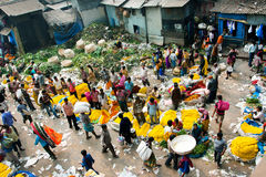 CALCUTTA, INDIA: View of Mullik Ghat Flower Market with people scurrying around Stock Photography