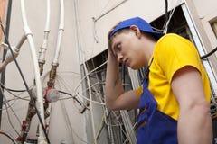 Caldaia del riscaldamento di Working On Central dell'idraulico Fotografia Stock Libera da Diritti