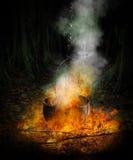 Caldeirão preto no fogo Fotografia de Stock Royalty Free