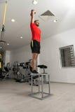 Caldera-campana de Exercising With del instructor de la aptitud Fotos de archivo
