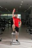 Caldera-campana de Exercising With del instructor de la aptitud Fotografía de archivo