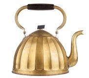 Caldera de té de oro Imagenes de archivo