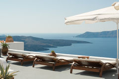 Caldera view. Sunbeds with caldera view on traditional terrace, Santorini royalty free stock photo