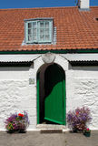Caldey Green. A white house with a green door on the island o Caldey off the Pembrokeshire coast Stock Images