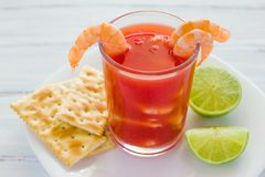 Caldo de camaron, consome de camarones, Shrimp cocktail with lemon and salted cookies mexican sea food in mexico stock photography