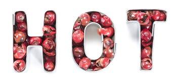 Caldo-segno (fatto dai granelli di pepe rosa) Fotografie Stock Libere da Diritti