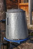Caldron. Old metallic caldron by the house stock images