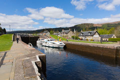 Caledonian canal Fort Augustus Scotland UK people moving boats in the locks Stock Image