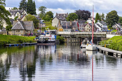 Caledonian Canal in Fort Augustus, Scotland. Fort Augustus, United Kingdom - August 19, 2014: The caledionan canal at the Loch Ness lake. The Canal connects the royalty free stock photo