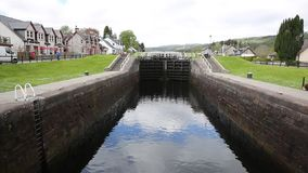 Caledonian canal lock gate Fort Augustus Scotland UK this waterway connects Fort William to Inverness stock video