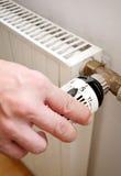 Calefacción y mano Imagen de archivo