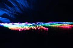 Caleidoscoop van multi-coloured exploderende lichten Royalty-vrije Stock Afbeeldingen