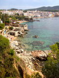 Calella de Palafrugell, Spain. Beach, bay, sea and town of Calella de Palafrugell, Catalonia, Spain. European holiday, vacation and tourism, for blue sky and sun stock photography