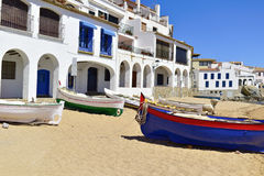 Calella de Palafrugell, Spain. Some old fishing boat stranded on the Barques Beach in Calella de Palafrugell, Costa Brava, Catalonia, Spain, with its Royalty Free Stock Photo