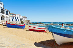 Calella de Palafrugell, Spain. Some old fishing boat stranded on the Barques Beach in Calella de Palafrugell, Costa Brava, Catalonia, Spain, with its Royalty Free Stock Photos