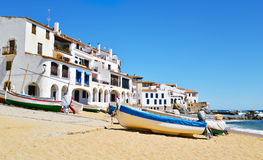 Calella de Palafrugell, Spain. Some old fishing boats stranded on the Barques Beach in Calella de Palafrugell, Costa Brava, Catalonia, Spain, with its Royalty Free Stock Photos