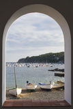 Calella de Palafrugell trought the arch Stock Photos