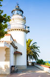 Calella Lighthouse is active lighthouse situated in coastal town of Calella in Costa del Maresme, Catalonia, Spain Royalty Free Stock Photo