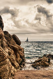 Calella seaside. A view on the sea at the costa brava in spain with a boat Royalty Free Stock Photography