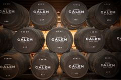 Calem port wine barrels in the caves at Porto Portugal. Calem port wine barrels being stored in the cool caves at Porto Portugal until it is ready to be bottled stock images