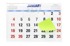 Calendário com papel de nota adesivo Imagens de Stock