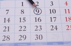 Calendário com um lápis preto Imagens de Stock