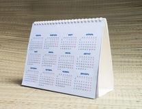 Calendário de papel no fundo bege Imagem de Stock Royalty Free